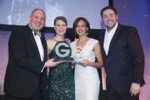 Promotional Campaign, Trade: Mila. Sarah Gyde received the award from Saint-Gobain's  Steve Severs.